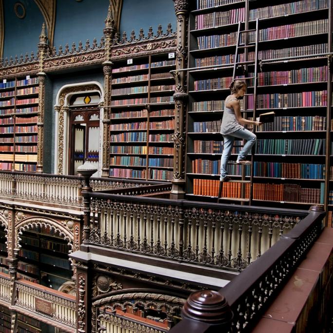 DSC_2998_es, Brazil, 03/13/2014. A woman on a library ladder.  retouched_Ekaterina Savtsova 03/23/2014